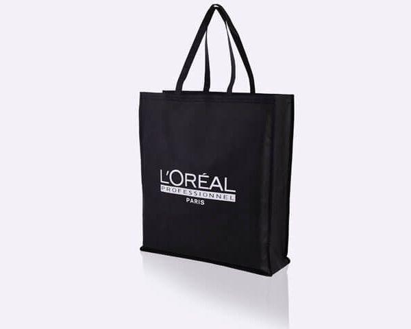 Black non-woben pp tote bag that says L'Oréal